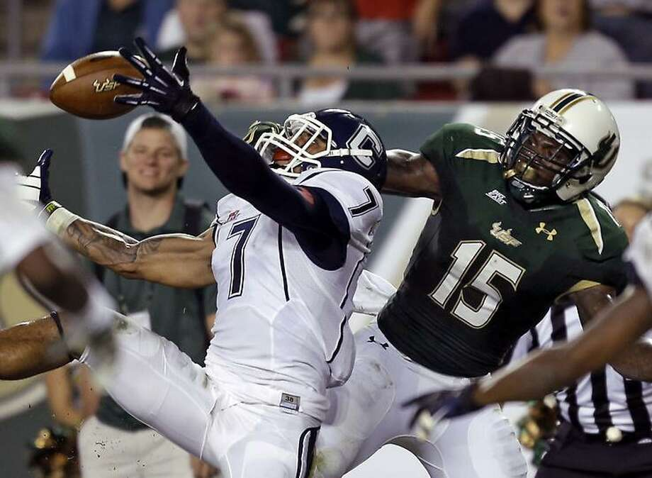 Connecticut cornerback Dwayne Gratz (7) intercepts a second-quarter pass intended for South Florida wide receiver Victor Marc (15) during an NCAA college football game on Saturday, Nov. 3, 2012, in Tampa, Fla. (AP Photo/Chris O'Meara) Photo: ASSOCIATED PRESS / AP2012