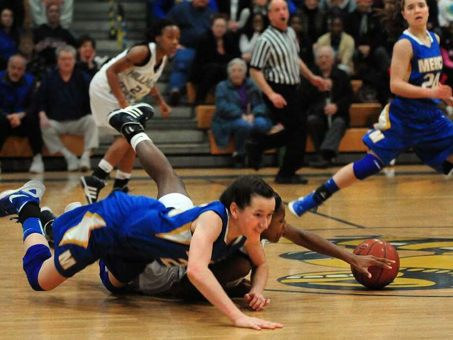 S[ports- Bria Holmes, of Hillhouse and Mercy's Maura Fitzpatrick dive for a loose ball in 2nd half action of the SCC Girls Basketball semi-finals.    Melanie Stengel/Register