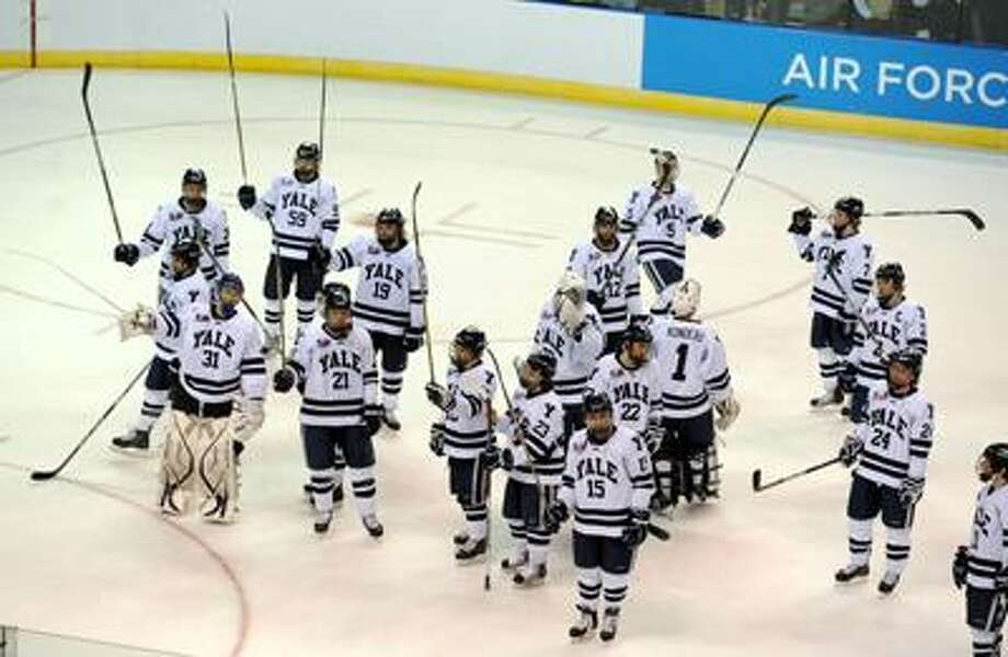 NCAA East Regional Final, Div. 1 Hockey between Yale and Univ. of MN-Duluth, 3rd period. Yale salutes the fans at the end of the game and their 5-3 loss. Photo by Mara Lavitt/New Haven Register3/26/11