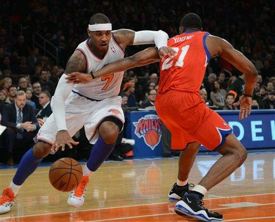 New York Knicks' Carmelo Anthony, left, drives on the Philadelphia 76ers' Thaddeus Young in the first quarter of the NBA basketball game at Madison Square Garden in New York, Sunday, Nov. 4, 2012. (AP Photo/Henny Ray Abrams) Photo: AP / FR151332 AP