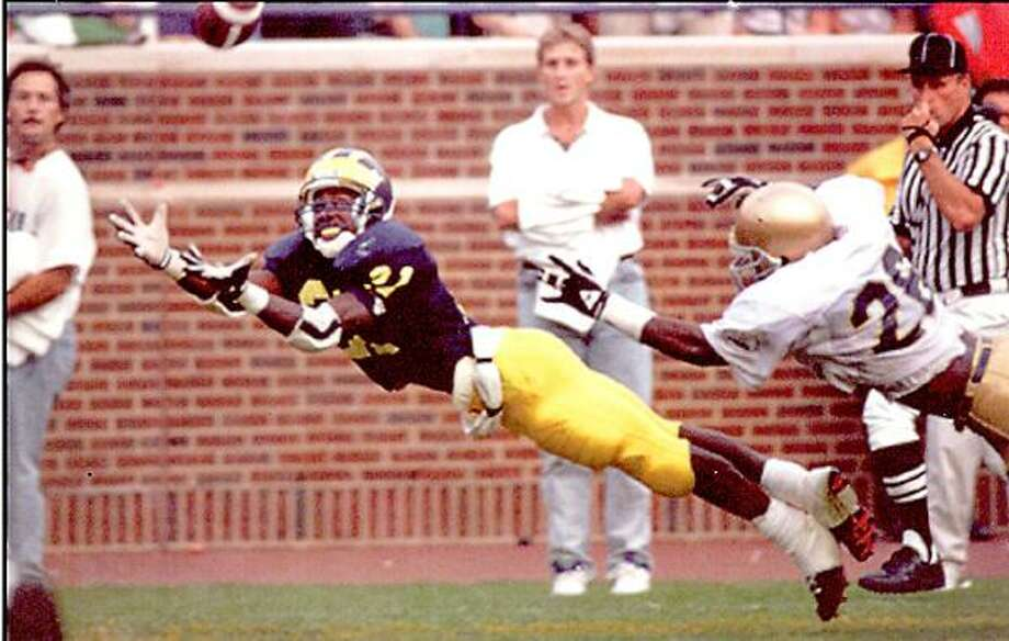Submitted Photo University of Michigan alum Desmond Howard leaps to make a 25-yard touchdown catch against Notre Dame on September 14, 1991. The touchdown propelled the Wolverines to a 24-14 win and helped clinch the Heisman Trophy for Howard. Currently an analyst for ESPN, Howard is the grand marshal for Sunday's Boxing Hall of Fame Parade of Champions in Canastota.