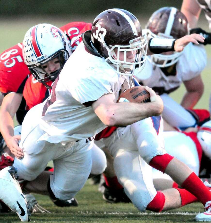 Ethan Suraci of North Haven dives over the goal line for a touchdown in the first half against Foran in Milford on 11/4/2012.Photo by Arnold Gold/New Haven Register