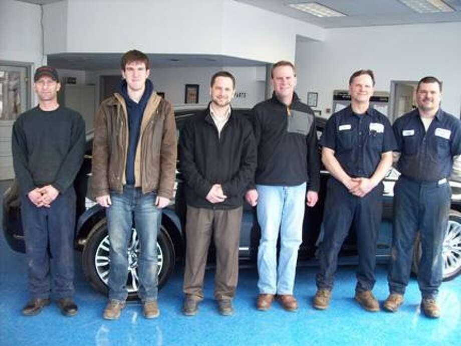 Photo Special to the Dispatch by MIKE JAQUAYS Morrisville Motors staff includes, from left, auto technician Doug Furness, parts manager Andy Pope, service manager Matt Polak, sales manager Craig Kelly, auto technician Tim Janczuk, and auto technician Gene Searl. Absent from photo is detailer Larry Featherly.