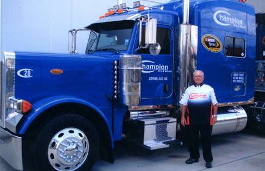 Submitted Photo Oneida High School alum Robert Malone stands in front of the truck he drives for Champion Tire and Wheel. The North Carolina company is owned by Jamie Rolewicz, a VVS alum, and it carries people and equipment for NASCAR.