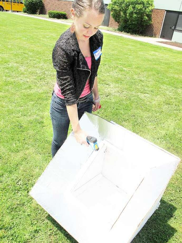 Photo by JOHN HAEGER (Twitter.com/OneidaPhoto) Bianca Little tests the temperature of her Solar Oven at Madison-Oneida BOCES on Wednesday, May 30, 2012 in Verona.