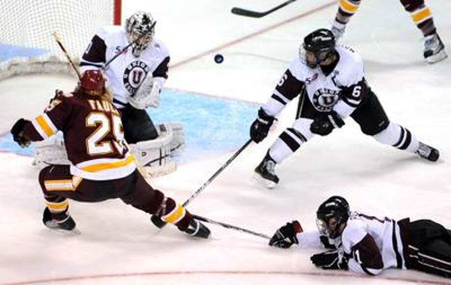 Union goalie Keith Kindaid, #30, and teammate Brock Matheson #6, second from right, and Justin Pallos, far right, defend against a shot by  Justin Faulk of Minnesota Duluth #25 during third period of the 2011 NCAA Men's Ice Hockey East Regional Friday afternoon 3/25/11 at the Arena at Harbor Yard in Bridgeport, Connecticut. Final: Minnesota Duluth 2-0 over Union.