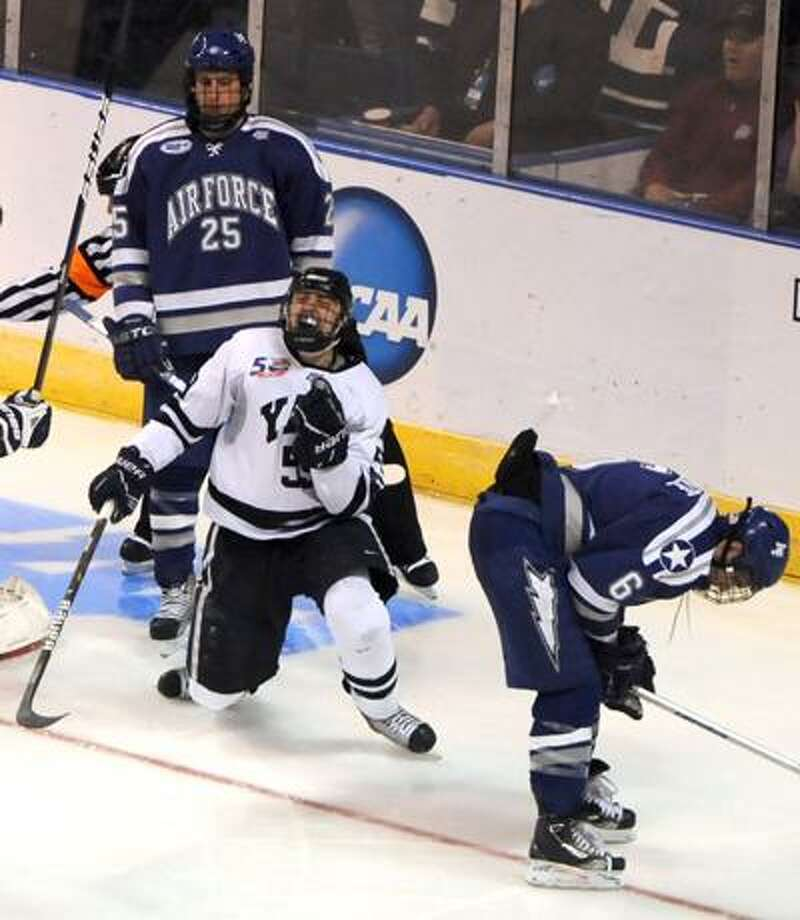 Chad Ziegler of Yale celebrates his scores and the winning goal against goalie Jason Torf of Air Force  Friday 3/25/11 during fourth period overtime action at the Arena at Harbor Yard in Bridgeport Connecticut  at the 2011 NCAA Men's Ice Hockey East Regional. Photo by Peter Hvizdak / New Haven RegisterMarch 25, 2011    ph2282