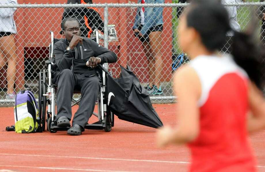 SCC Track championships, Sheehan H.S. Wallingford: Coach Gary Moore watches the 1600m race.  Mara Lavitt/New Haven Register5/21/12