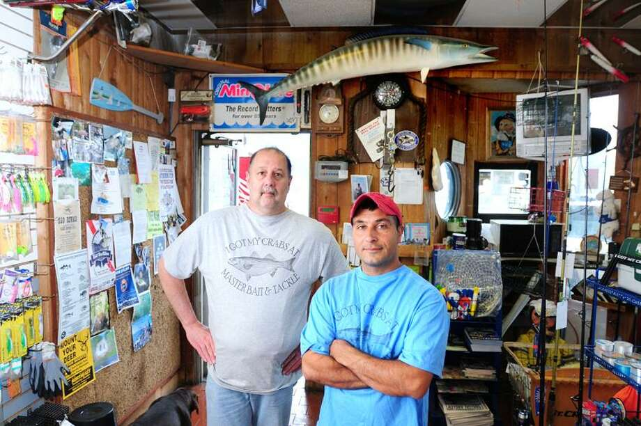 Store manager John Mikos, left, and owner Bob Bishop are photographed in the reopened Master Bait and Tackle in East Haven. Photo by Arnold Gold/New Haven Register