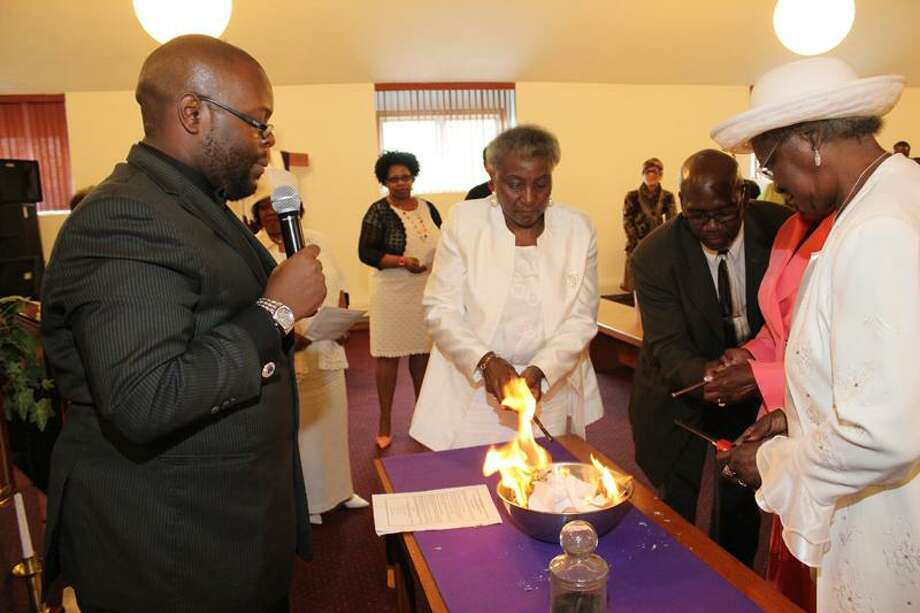 From left, the Rev. Brian Bellamy, Sister Betty Evans, Minister Kenny Myers, Sister Verna M. Simms (obscured) and Deaconess Lily Moss.