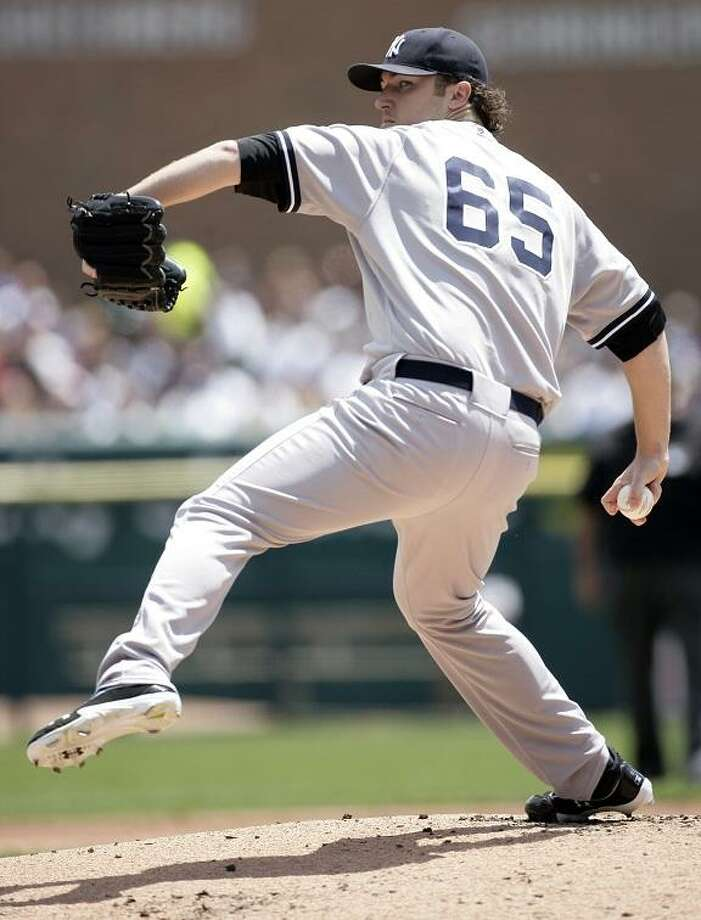New York Yankees starter Phil Hughes pitches against the Detroit Tigers in the first inning of baseball game on Sunday, June 3, 2012, in Detroit. (AP Photo/Duane Burleson) Photo: ASSOCIATED PRESS / AP2012