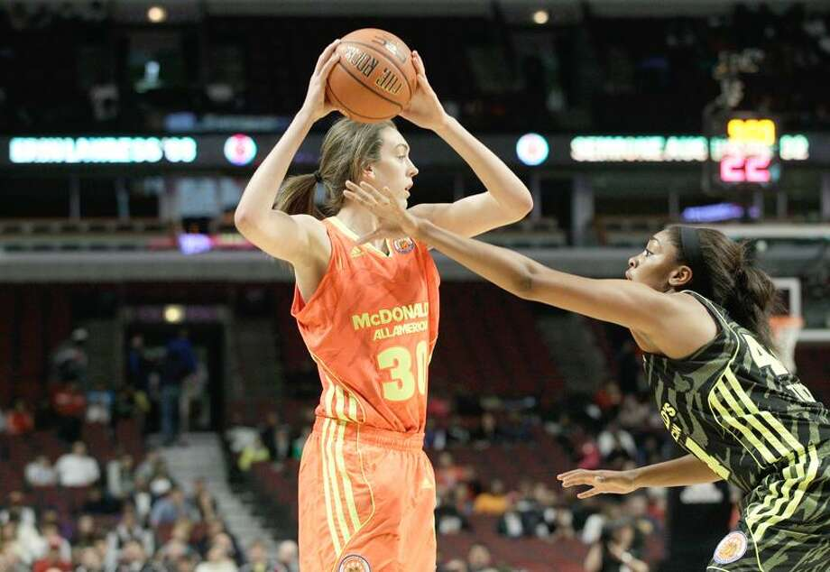 McDonald's East All-American Breanna Stewart (30) looks to pass the ball as McDonald's West All-American Morgan Tuck (44)  blocks her during the first half of the McDonald's All-American Women's basketball game in Chicago, Wednesday, March 28, 2012. (AP Photo/Nam Y. Huh) Photo: AP / AP2012