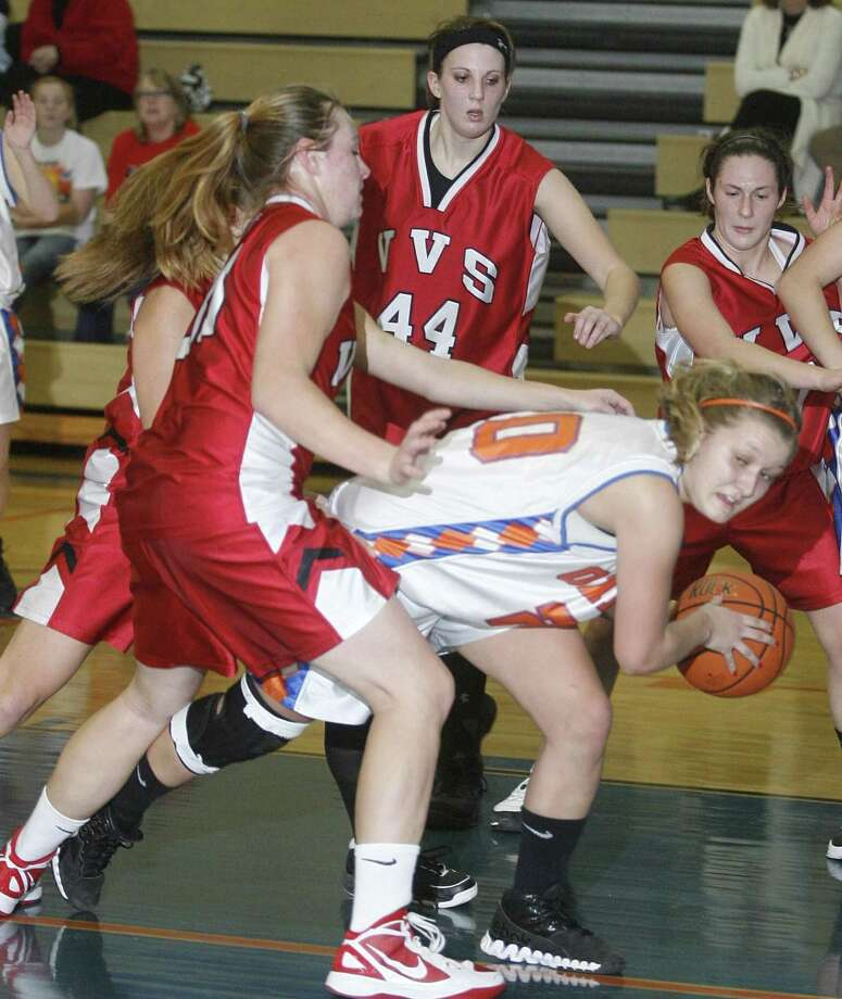 """Dispatch Staff Photo by JOHN HAEGER <a href=""""http://twitter.com/oneidaphoto"""">twitter.com/oneidaphoto</a> Oneida's Jaclyn Cavanagh (20) looks to pass as she is pressured by VVS players in the third quarter at Oneida on Tuesday, Dec. 6, 2011."""