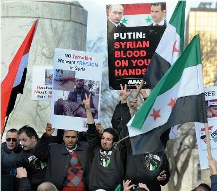 Syrians and others on the Lower New Haven Green protested the plight of the Syrian people and Russia and China's support of the Syrian regime. Photo by Mara Lavitt/New Haven Register  2/17/12