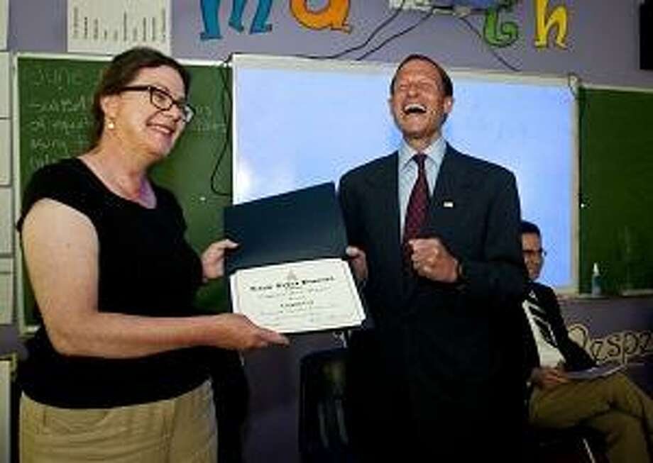 NEW HAVEN-Liaznne  Cox with Sen. Richard Blumenthal at Common Ground High School. Cox received a Presidential Innovation Award for Environmental Educators  two $2,00 checks from the EPA, and a Certificate of Special Recognition from Blumenthal.     Melanie Stengel/Register
