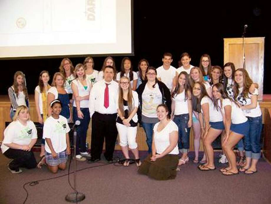 Photo Courtesy CANASTOTA HIGH SCHOOL Canastota students pose in the auditorium wearing white shirts to show they are united against bullying.
