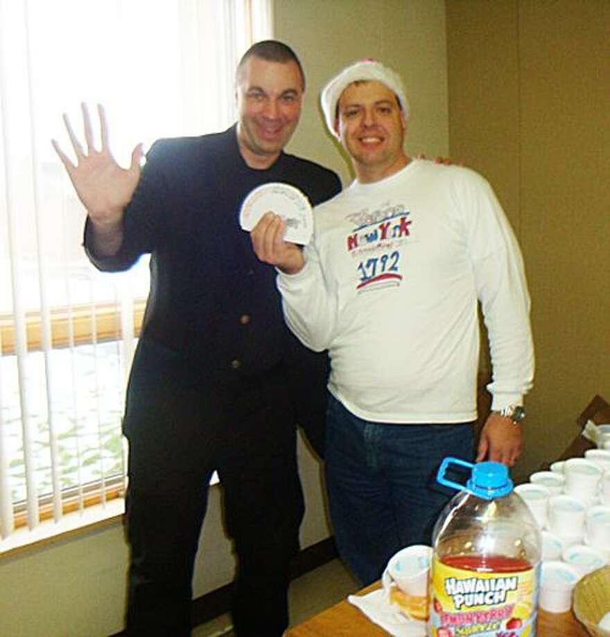 Photo Courtesy FRITZ SCHERZ From left is Matt Episcopo and Fritz Scherz at last year's Holiday Party.