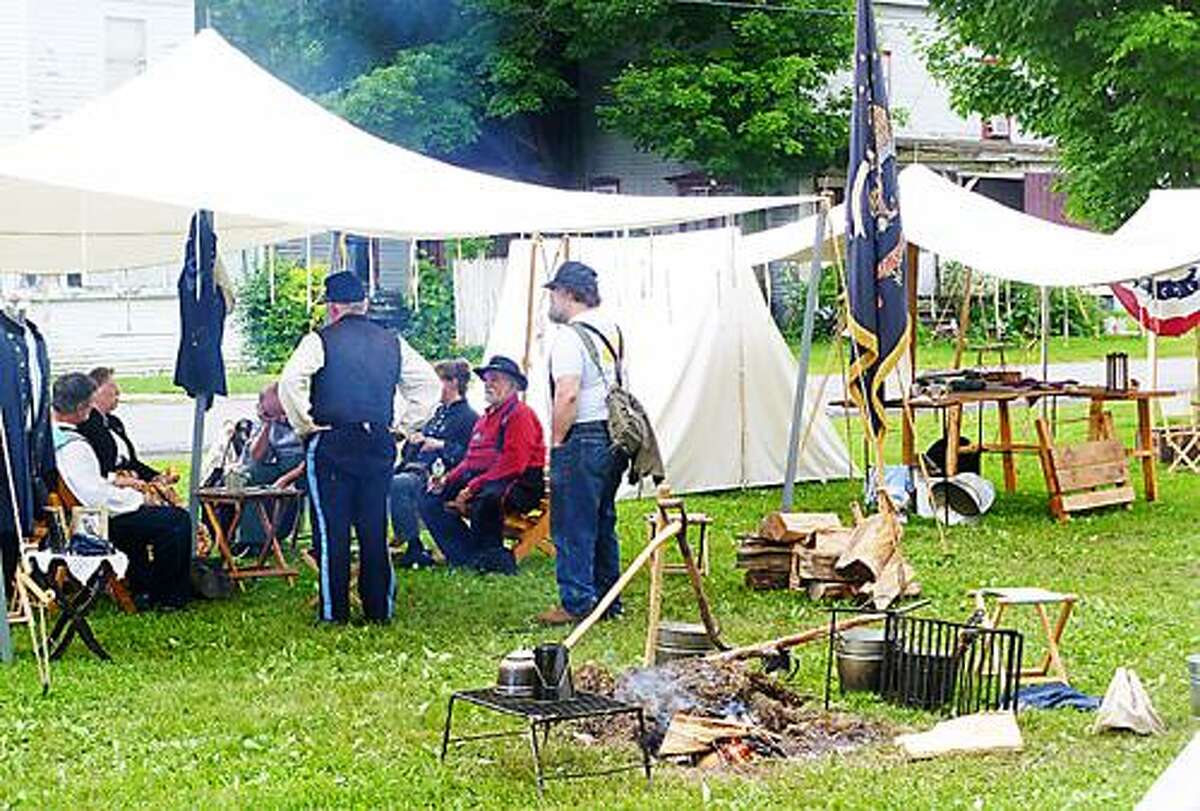 Photo Courtesy ABOLITION HALL OF FAME AND MUSEUM Reenactors relax on the village green in Peterboro during a previous Civil War Weekend.