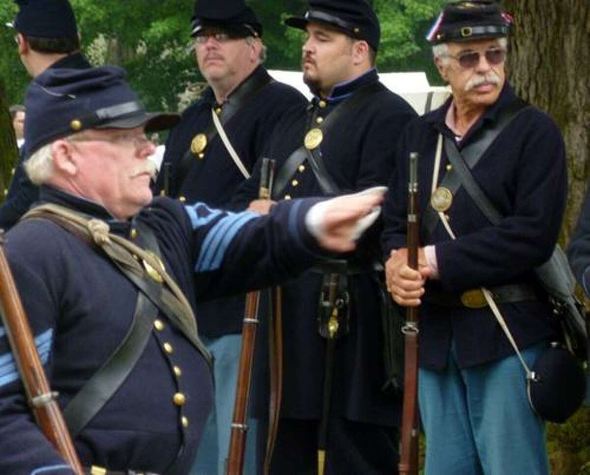 Photo Courtesy ABOLITION HALL OF FAME AND MUSEUM Sgt Neil MacMillan drills members of the 12th U.S. Regiment U.S. Infantry, Co. A. (Reenacting) the host military unit for the annual Peterboro Civil War Weekend upcoming June 9 and 10.