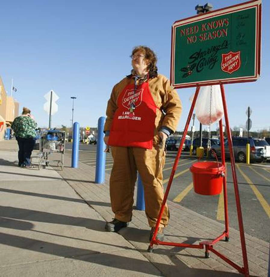 Dispatch Staff Photo by JOHN HAEGER (Twitter.com/OneidaPhoto)Salvation Army Bell Ringer Julie Tippie mans the kettle outside of Walmart in Oneida on Thursday, Dec. 1, 2011.