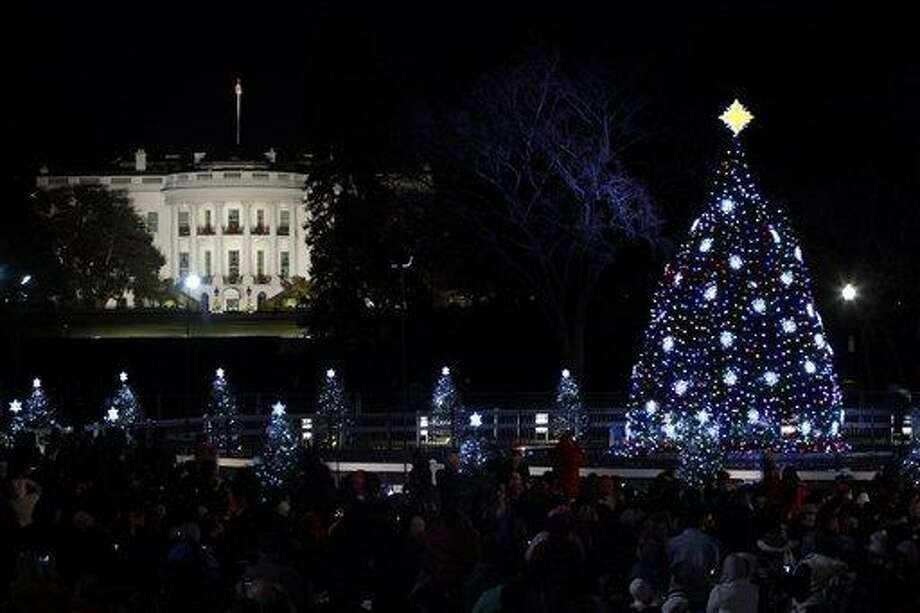 The National Christmas Tree is pictured after it was lit by President Barack Obama, first lady Michelle Obama, daughters Malia and Sasha Obama and and mother-in-law Marian Robinson, at the Ellipse across from the White House in Washington, Thursday, Dec., 1, 2011. (AP Photo/Pablo Martinez Monsivais) Photo: AP / AP