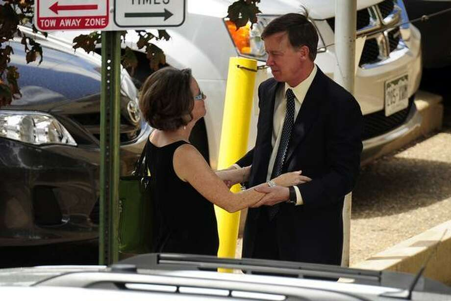 Governor John Hickenlooper hugs his wife, Helen Thorpe, following a memorial service for Gordon Ware Cowden, one of 12 victims who died during the Aurora Theater Shooting, at the Pathways Church on Wednesday, July 25, 2012. AAron Ontiveroz, The Denver Post Photo: DP / (C) 2012 The Denver Post, MediaNews Group