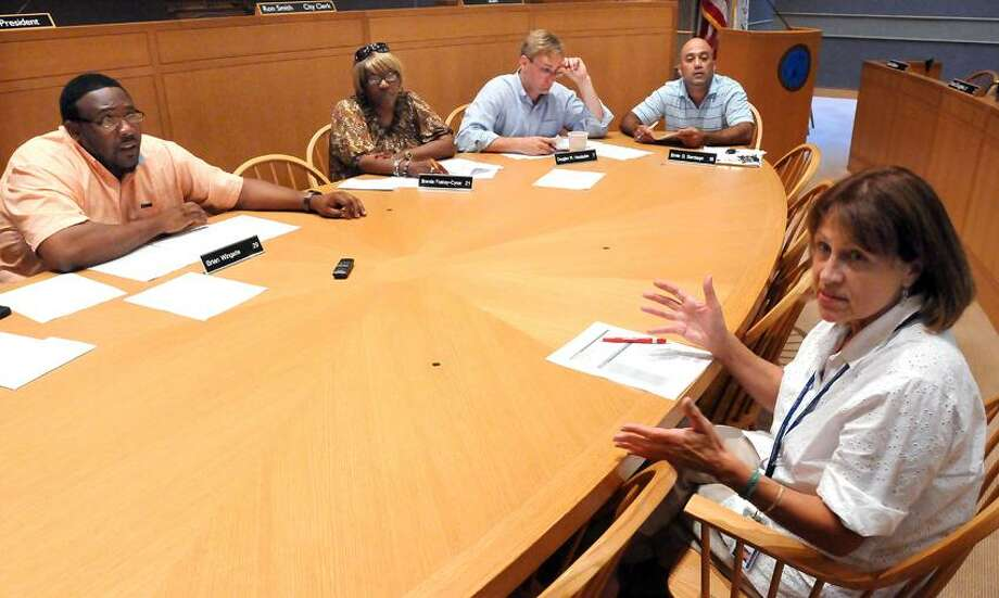New Haven's Deputy Director of Emergency Management Maggie Targove, right, addresses the city's Public Safety Committee. From left, Brian Wingate, Brenda Foskey-Cyrus, Douglas Hausladen and Ernie Santiago. Mara Lavitt/New Haven Register