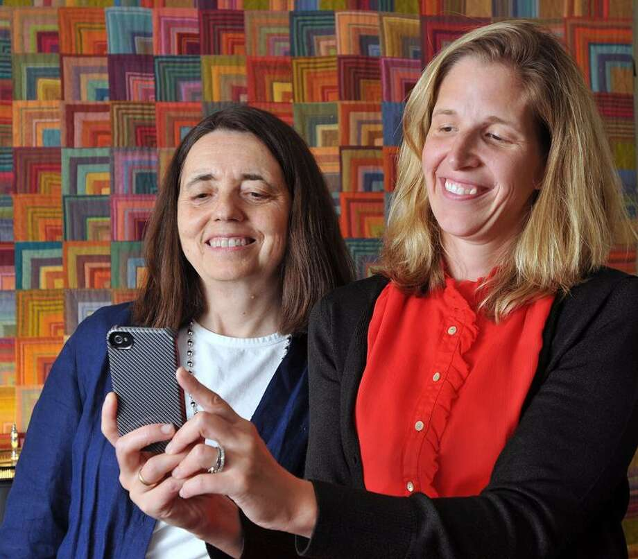 "Dr. Megan Smith, left, and Dr. Linda Mayes are designing a smartphone application for first-time, low-income mothers called ""Momba."" The two researchers work at the Yale Child Study Center.  Peter Casolino/New Haven Register"