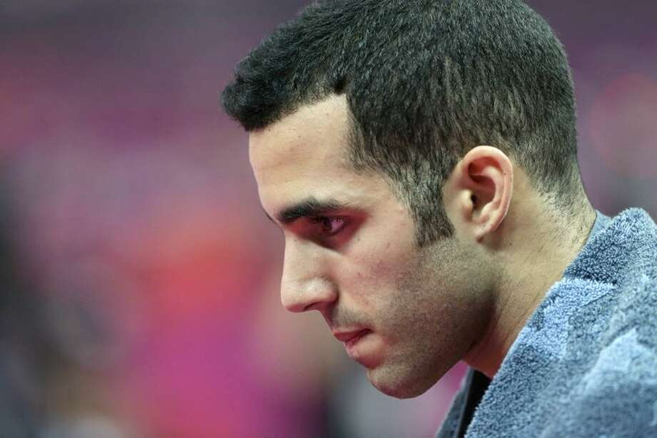 U.S. gymnast Danell Leyva walks after a performance during the Artistic Gymnastic men's team final at the 2012 Summer Olympics, Monday, July 30, 2012, in London. (AP Photo/Julie Jacobson) Photo: AP / AP