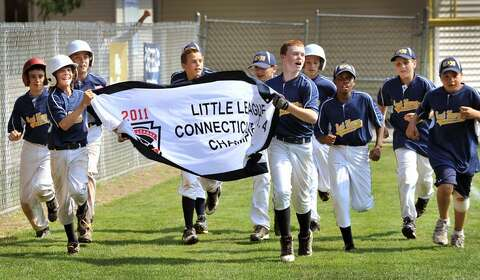 Sports The East Haven Little League Team Circles Field After Defeating Hamden In District