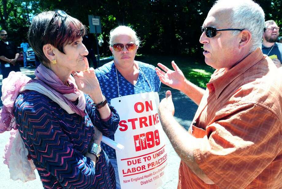 U.S. Rep Rosa DeLauro, left, speaks with Noreen Gates, center, and New England Health Care Employees Union Local 1199 president Dave Pickus, right, in front of West River Health Care Center in Milford where employees are on strike. Gates has been employed as a central supply coordinator for 20 years at the center. Photo by Arnold Gold/New Haven Register