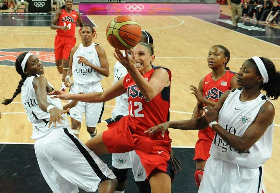 United States' guard Diana Taurasi, center, vies for the ball with Angola's forward Sonia Guadalupe, right, and Angola's center Luisa Tomas, left,  during their women's preliminary round group A basketball match at the 2012 Summer Olympics on Monday, July 30, 2012, in London. (AP Photo/Mark Ralston, Pool) Photo: AP / AP2012