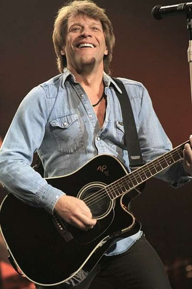 "Singer, songwriter and guitarist Jon Bon Jovi is shown performing on stage during a ""live"" concert appearance with Bon Jovi. Photo: John Atashian / John Atashian"