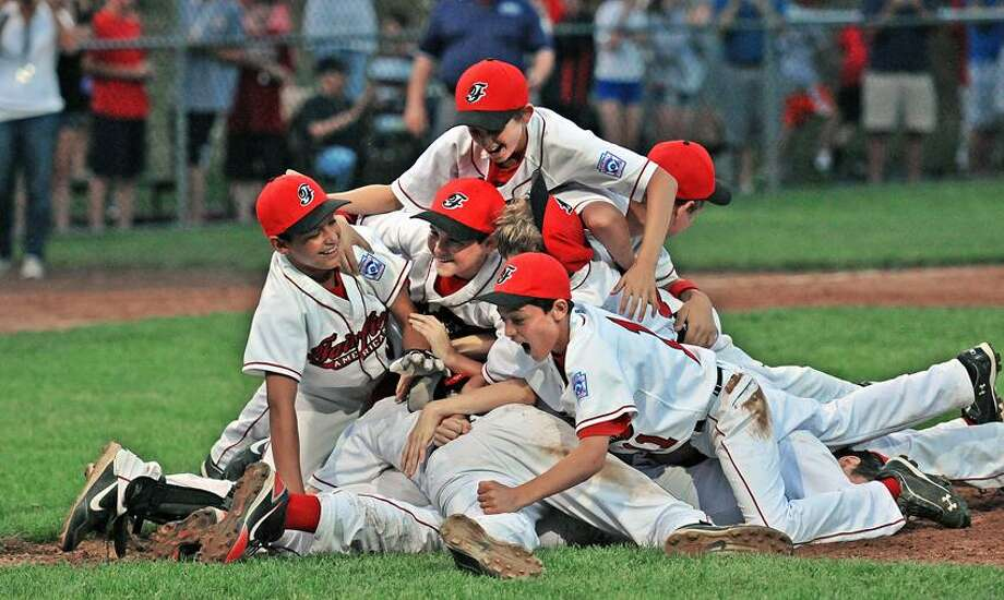 New Haven--Fairfield American celebrates their win over Avon for the State Championship Little League title. Fairfield American beat Avon 10-0 in 4 inningsPeter Casolino/New Haven Register 7/29/12