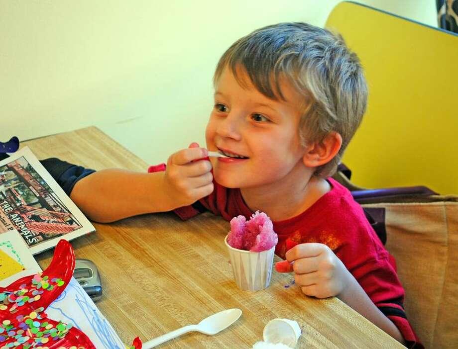 Miles Tibor, 4, enjoys some Italian ice at Addeo's Italian Ice. Photo by Jen Fengler/for the Register