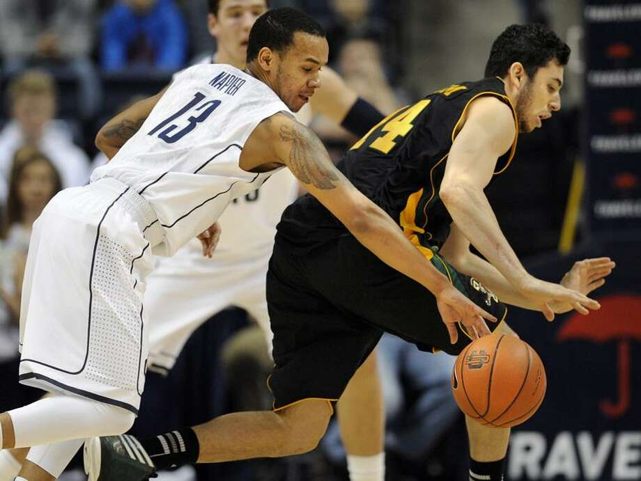 Connecticut's Shabazz Napier, left, steals the ball from Vermont's Josh Elbaum during the first half of an NCAA college basketball game against, Tuesday, Nov. 13, 2012, in Storrs, Conn. (AP Photo/Jessica Hill) Photo: AP / A2012