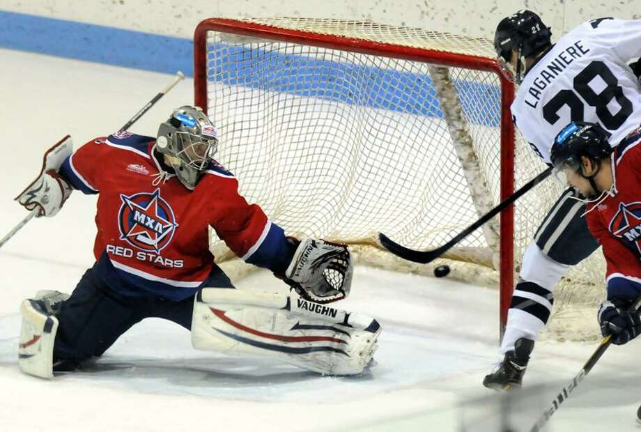 The Russian Red Stars played Yale in hockey, Ingalls Rink. Yale's 5th goal against Russia scored by Antoine Laganiere right against Russia's goalie Denis Peretiagin. Mara Lavitt/New Haven Register12/28/12