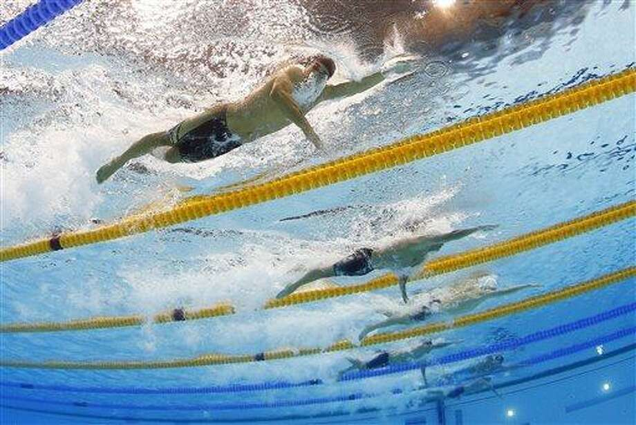 United States' Ricky Berens, top, United States' Ryan Lochte, center, and China's Sun Yang, top, compete in a men's 200-meter freestyle swimming heat at the Aquatics Centre in the Olympic Park during the 2012 Summer Olympics in London, Sunday, July 29, 2012. (AP Photo/David J. Phillip) Photo: ASSOCIATED PRESS / AP2012