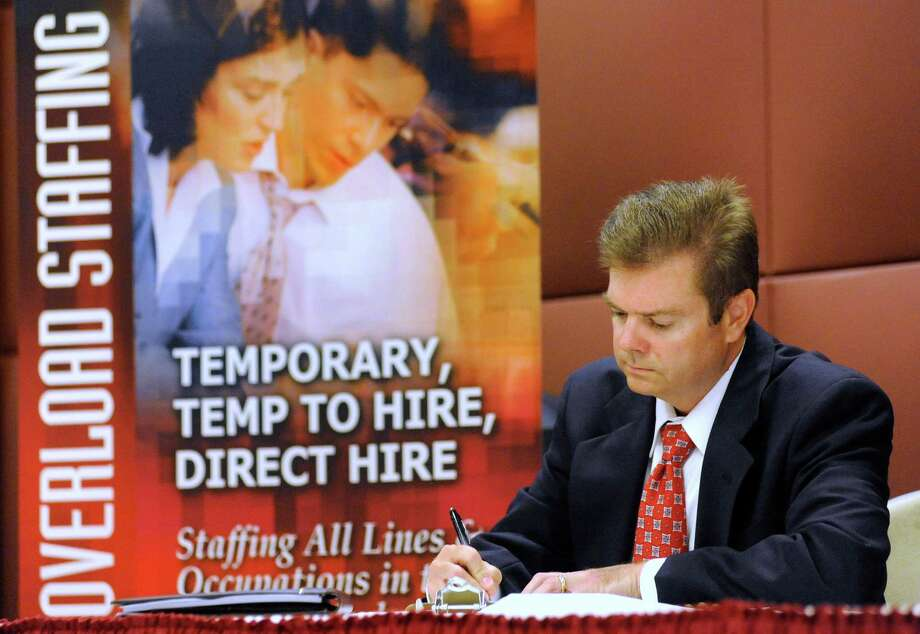 In this May 24 photo, unemployed electrical engineer William Love of Pasadena, Md., whose unemployment benefits have been exhausted, fills out an application for a sales position at a job fair in Linthicum, Md. The number of job postings didn't increase in May, a sign that hiring is unlikely to pick up this summer.(AP Photo/Steve Ruark) Photo: AP / FR96543 AP