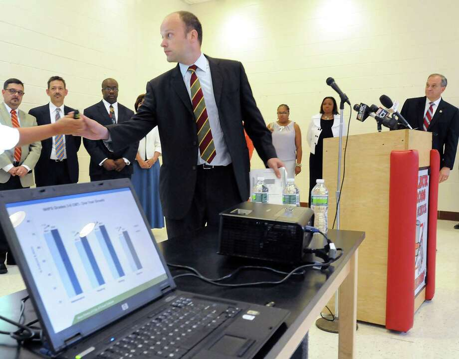 At Wilbur Cross High School New Haven officials announced the latest CMT and CAPT scores. Assistant superintendent of schools Garth Harries makes a power point presentation. Photo by Mara Lavitt/New Haven Register7/13/11