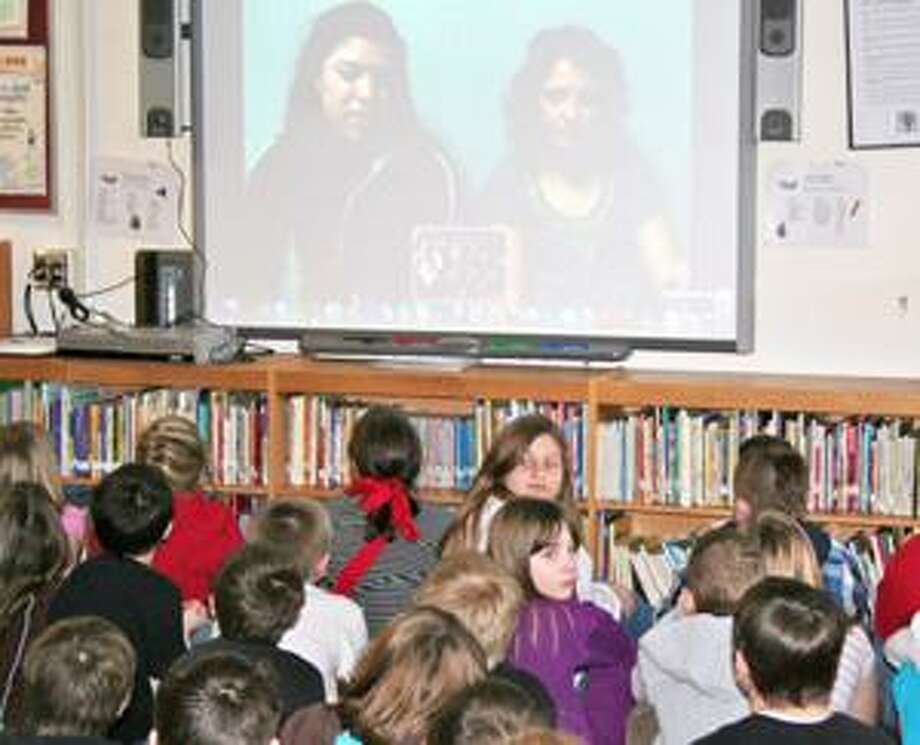 Photo Courtesy E. R. ANDREWS ELEMENTARY Students from E. R. Andrews Elementary School in Morrisville talk with Alaska Pacific University students Haley Williams and Annie Grenier over Skype to discuss the Iditarod dog sledding race.