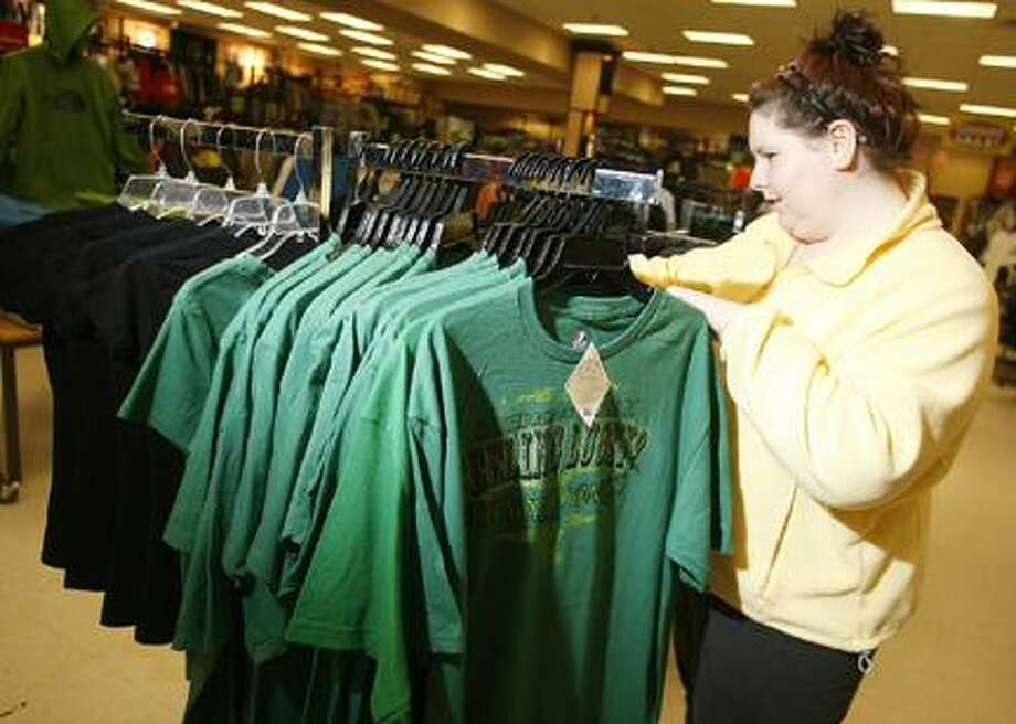Photo by JOHN HAEGER Ashley Roycraft of Bridgeport shops at Herb Philipson's in Oneida on Tuesday, March 15, 2011.