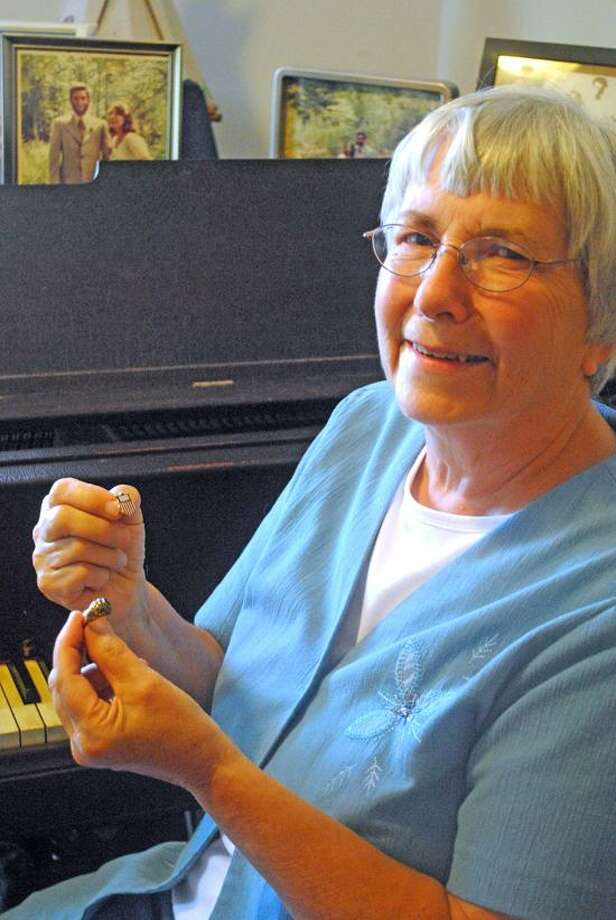 Jen Fengler/Register intern: Her skills were musical, not athletic, but pianist Pat Bissell of New Haven was just as much a team member, as evidenced by her ring and pin from the 1968 U.S. women's Olympic gymnastics team.