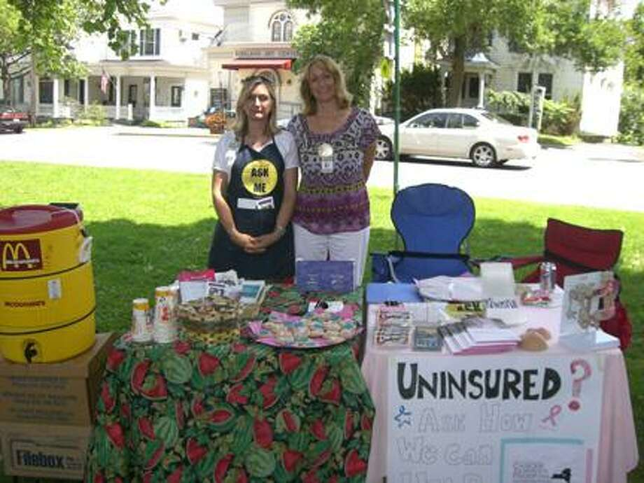 Photo Courtesy WENDY HUNT Spreading the word about the Cancer Services Program at the Clinton Farmers Market are, from left, Case Manager Lynda Kiefer and Data Manager Robin Potenski.