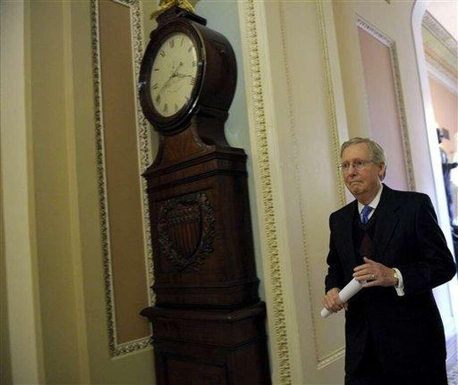 Senate Minority Leader Mitch McConnell of Ky. walks to the Senate floor on Capitol Hill in Washington, Thursday, Dec. 27, 2012. (AP Photo/Susan Walsh) Photo: AP / AP