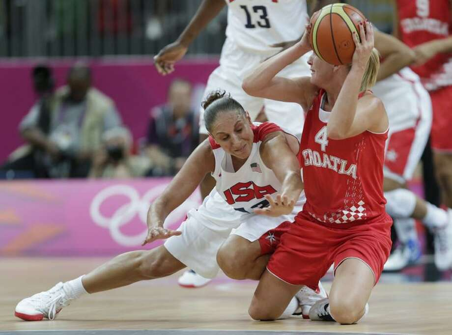 United States guard Diana Taurasi, left, tries to steal as Croatia guard Sandra Mandir drops to the floor during a basketball game at the 2012 Summer Olympics, Saturday, July 28, 2012, in London. (AP Photo/Charles Krupa) Photo: AP / AP2012