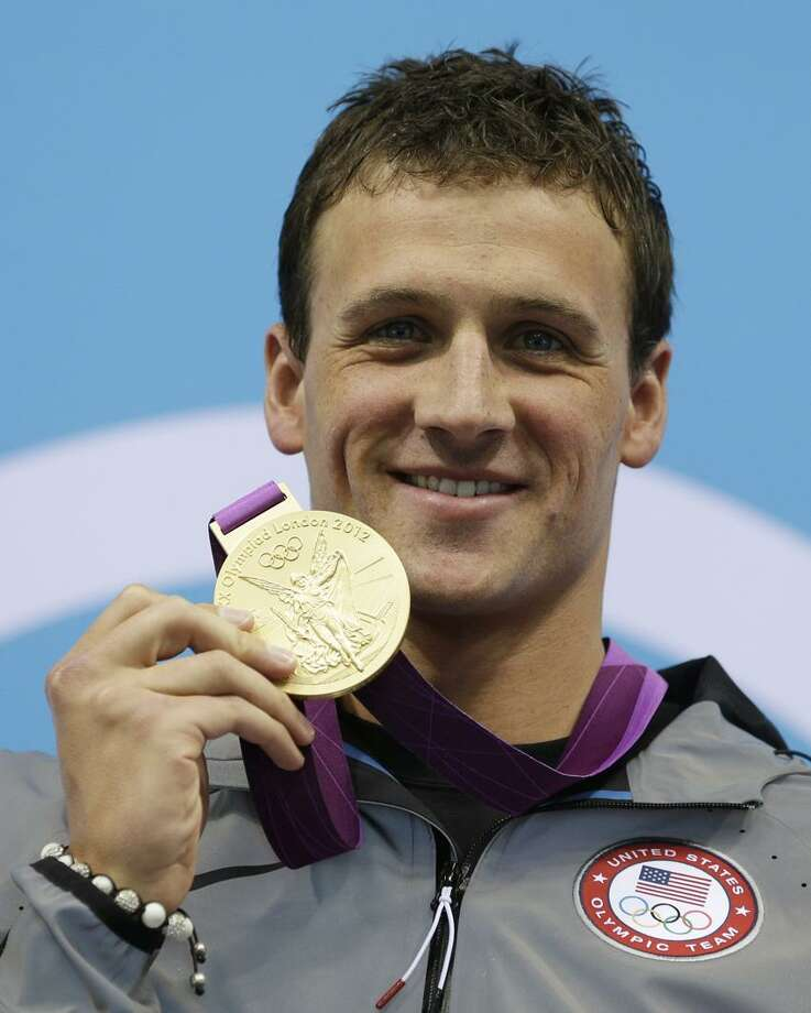 United States' Ryan Lochte poses with his gold medal for the men's 400-meter individual medley swimming final at the Aquatics Centre in the Olympic Park during the 2012 Summer Olympics in London, Saturday, July 28, 2012. (AP Photo/Michael Sohn) Photo: AP / AP