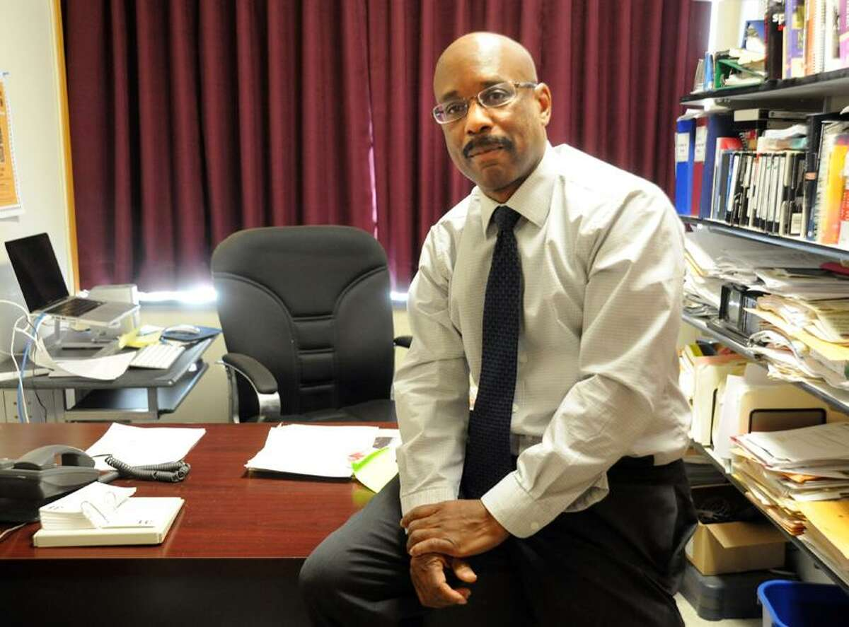 SCSU Professor Frank Harris, who wrote a book about names that have been used to describe blacks, in his office. VM Williams/Register
