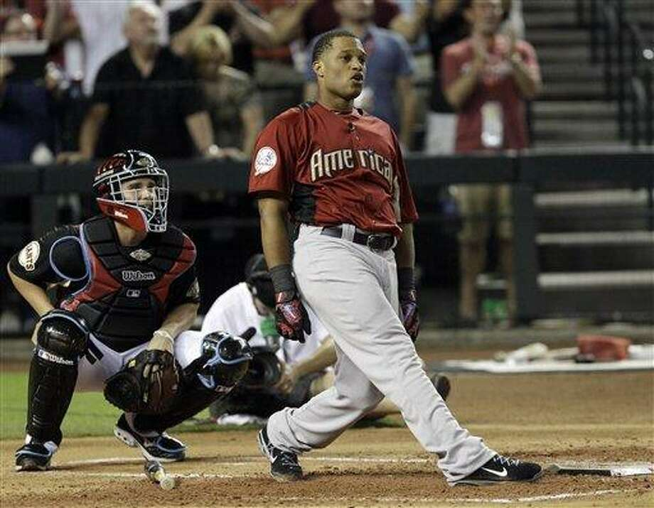 American League's Robinson Cano of the New York Yankees watches his winning home run during the final round of the MLB Home Run Derby Monday, July 11, 2011, in Phoenix. (AP Photo/David J. Phillip) Photo: AP / AP