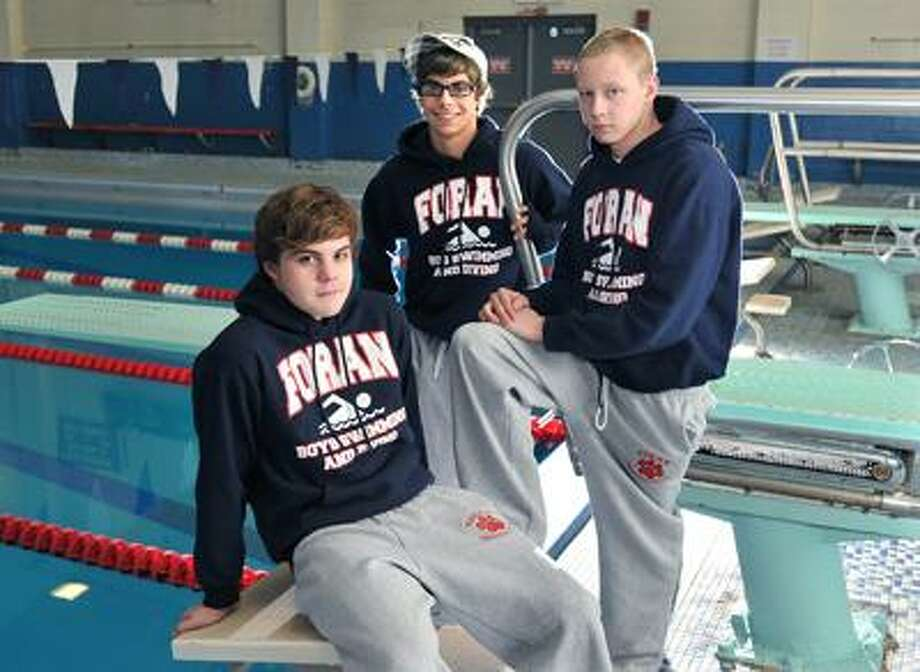 Milford-- Foran swim team captains, from left to right; Rodger McDonald, Rich Enders and Dylan Swanepoel.  Photo by Peter Casolino/New Haven Register03/14/11 Cas110314